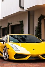 Preview iPhone wallpaper Yellow Lamborghini supercar, villa