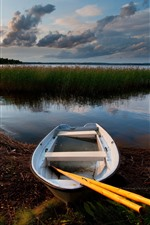 Preview iPhone wallpaper Boat, lake, dusk, reeds, clouds