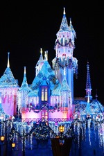 Preview iPhone wallpaper Disneyland, beautiful castle, colorful lights, night