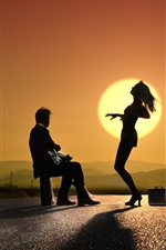 Guy and dancing girl, sunset, silhouette