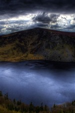 Preview iPhone wallpaper Ireland, lake, mountains, thick clouds, storm
