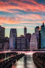 Preview iPhone wallpaper Manhattan, sunset, river, stump, skyscrapers, clouds
