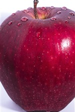One red apple, water droplets, white background