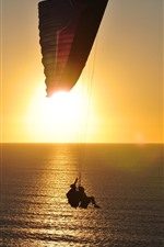 Preview iPhone wallpaper Sea, surface, parachute, sunrise, glare