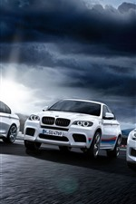 Preview iPhone wallpaper Three white BMW cars front view