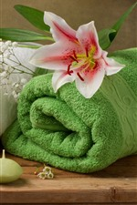 Two towels, bowl, candle, lily