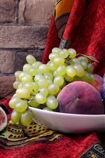 Green grapes, figs, peach, wine