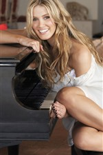 Happy blonde girl, piano