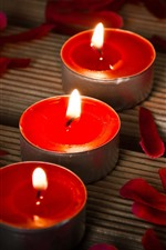 Preview iPhone wallpaper Three red candles, flame, petals