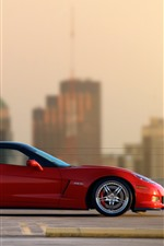 Preview iPhone wallpaper Chevrolet Corvette red supercar side view, city