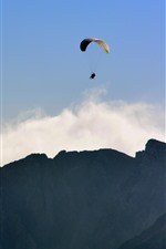 Preview iPhone wallpaper Paraglider, flying, mountains, clouds, sky