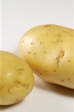 Duas batatas, vegetais