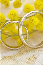 Preview iPhone wallpaper Wedding rings, yellow flowers