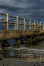 Preview iPhone wallpaper Dock, bridge, sea, stones, dusk