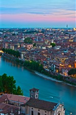 Preview iPhone wallpaper Italy, river, houses, city, bridge, lights, dusk