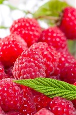 Preview iPhone wallpaper Red raspberry, berries, green mint leaves