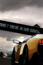 Preview iPhone wallpaper Yellow Lamborghini rear view, night