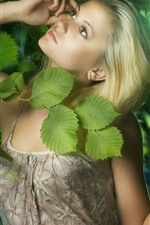 Preview iPhone wallpaper Blonde girl, green leaves, sunshine