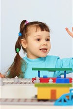 Cute little girl play toys, child