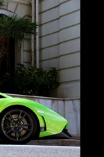 Preview iPhone wallpaper Lamborghini green supercar side view, palm trees