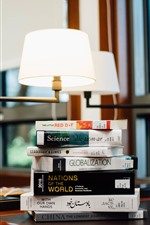 Some books, table, window