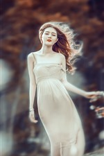 Preview iPhone wallpaper Asian girl in the wind, skirt, trees