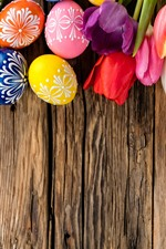 Preview iPhone wallpaper Colorful Easter eggs, tulips, wood board