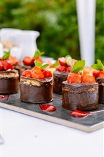 Some chocolate cakes, strawberry, dessert