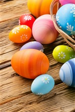 Preview iPhone wallpaper Some colorful Easter eggs, basket, wood table