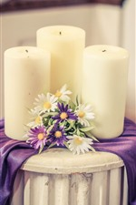 White candles and flowers, table