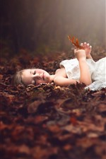 Preview iPhone wallpaper Cute little girl sleep on ground, white skirt, leaves