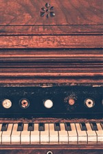 Preview iPhone wallpaper Old piano, keys