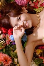Preview iPhone wallpaper Smile Asian girl, skirt, flowers