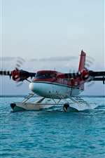 Preview iPhone wallpaper Airplane landing on water