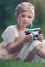 Preview iPhone wallpaper Cute little girl use camera, meadow