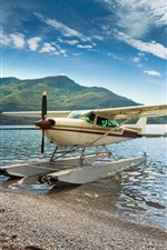 Preview iPhone wallpaper Hydroplane, plane, wings, lake, lakeshore, mountains
