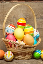 Preview iPhone wallpaper One basket of Easter eggs, wood board