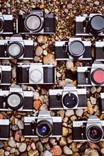 Algumas câmeras, pedras