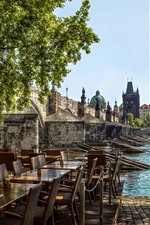 Preview iPhone wallpaper Prague, Czech Republic, cafe, tables, chairs, river, bridge