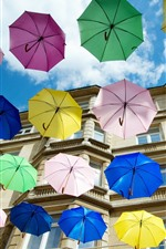 Preview iPhone wallpaper Some colorful umbrellas, house, city