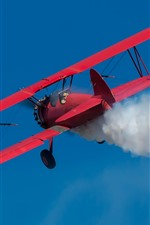 Preview iPhone wallpaper Boeing red biplane, smoke, sky