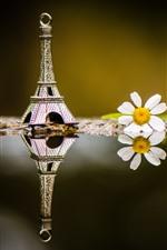 Eiffel Tower decoration, white flower, water