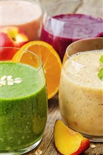 Four cups smoothies, fruit drinks, colorful