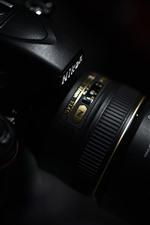 Câmera nikon, lente, fundo preto