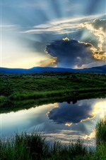 Preview iPhone wallpaper Grass, lake, green, sky, clouds, sun rays, dusk