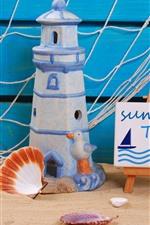 Still life, sands, lighthouse toy, starfish, shell