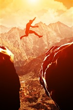 iPhone обои Закат, камни, человек, прыжки, горы