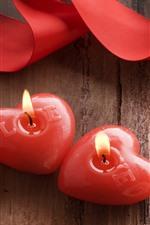 Duas velas do coração do amor vermelho, fita
