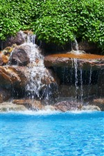Preview iPhone wallpaper Blue water, pool, green leaves, waterfall, stones