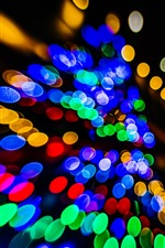 Preview iPhone wallpaper Colorful light circles, black background, shine